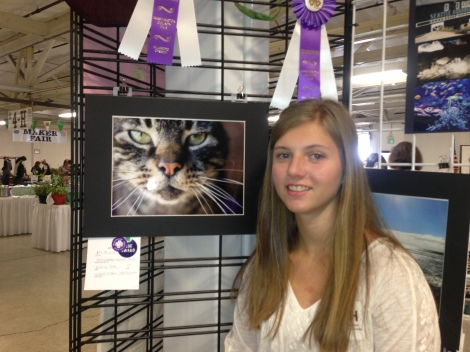 A reserve champion ribbon for Jasmine's photography as well as three pictures qualifying for state fair